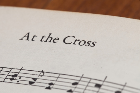 sheetmusic: CHIANGMAI, THAILAND, April 21,2015. Singing The Christian Hymnal book on the song of  At the Cross  at home. April 21,2015