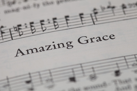 sheetmusic: CHIANGMAI, THAILAND, April 21,2015. Singing The Christian Hymnal book on the song of  Amazing Grace  at home. April 21,2015