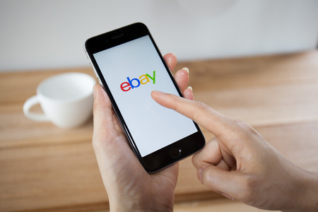 ebay: CHIANGMAI,THAILAND - APRIL 26, 2015:iPhone opened to Ebay homepage. Ebay, an online auction and shopping site, was founded in 1995.