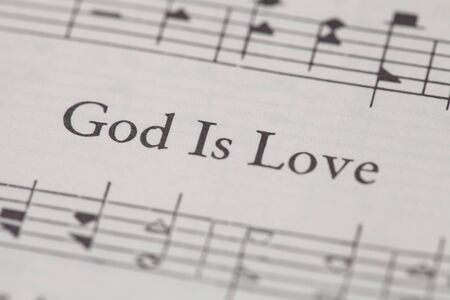 sheetmusic: CHIANGMAI, THAILAND, April 21,2015. Singing The Christian Hymnal book on the song of  God is Love  at home. April 21,2015 Editorial