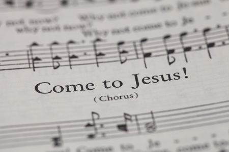 sheetmusic: CHIANGMAI, THAILAND, April 21,2015. Singing The Christian Hymnal book on the song of  Come to Jesus  at home. April 21,2015
