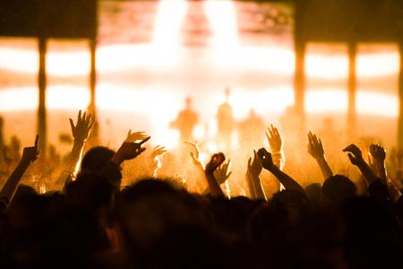 concert: De-focused concert crowd.