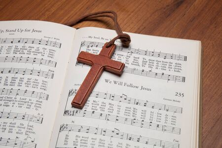 sheetmusic: CHIANGMAI, THAILAND, April 19,2015. Singing The Christian song book on the song of  We will folloe Jesus  at home. April 19,2015