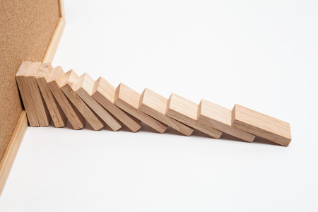 consequence: Domino effect - row of white dominoes on white background Stock Photo