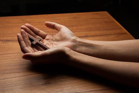 jesus hands: Wooden cross in the hands