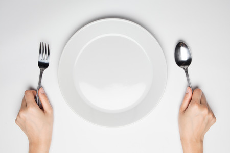 fork and spoon and empty plate Фото со стока