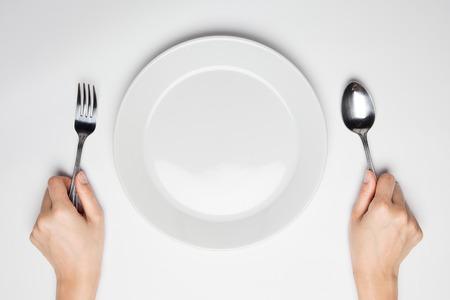 cuchara: tenedor y cuchara y plato vacío Foto de archivo
