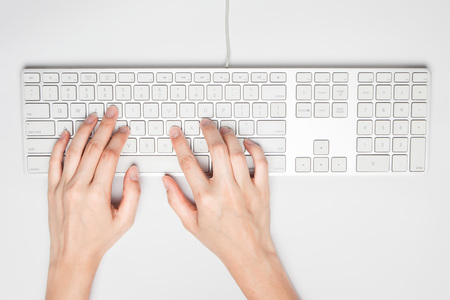 qwerty: Hands working on the keyboard Stock Photo