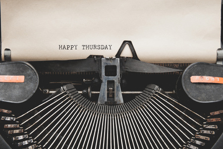 thursday: Happy Thursday on typewriter , vintage tone. Stock Photo