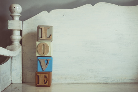 spelled: Vintage tone of word LOVE spelled out on a row of lettered Stock Photo