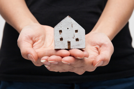 both: House Wooden in both hands Stock Photo