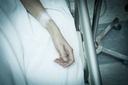 anaesthetic: a hand of a patient during a surgical operation - closeup Stock Photo