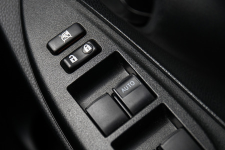 jacked: Car Door Lock Button Closeup. Electric Locking Button in Modern Car