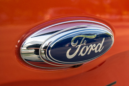 automaker: CHIANGMAI,THAILAND-DECEMBER 18,2015: Ford Sign Close-Up in Chiangmai, Thailand. The Ford Motor Company is an American multinational automaker. Ford is the second-largest U.S.-based automaker.