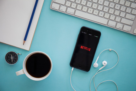 CHIANG MAI,THAILAND - MARCH 17, 2016:Apple iPhone with Netflix application on the screen. Netflix is a provider of on-demand Internet streaming media, and of flat rate DVD-by-mail in the United States Editoriali