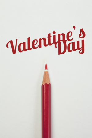 red pencil: Red pencil and a red heart with valentines day word