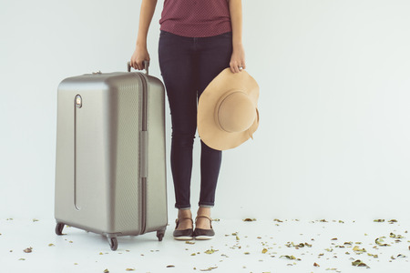 exciting: Vintage tone of Exciting Asian woman drag a luggage