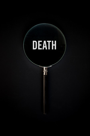 vitreous: magnifier glass with Death text