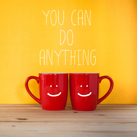 anything: You Can Do Anything text on yellow background with coffee cup Stock Photo