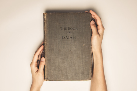 isaiah: Vintage tone of hands hold the book bible of isaiah