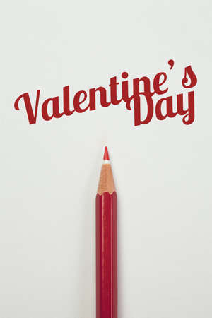 red pencil: Red pencil and a red heart with valentine word