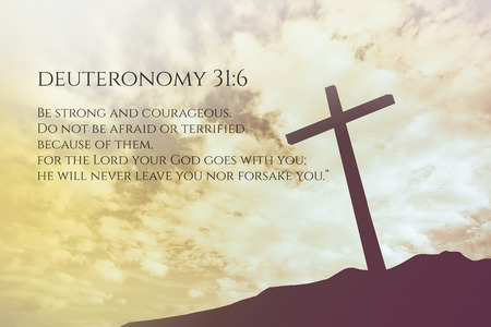 verse: Deuteronomy 31:6 Vintage Bible Verse Background on one cross on a hill Stock Photo