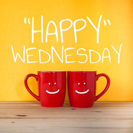 Happy wednesday word.Two cups of coffee and stand together to be heart shape on yellow background with smile face on cup.