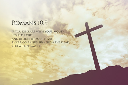 verse: Romans Vintage Bible Verse Background on one cross on a hill Stock Photo