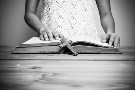 able to learn: A close-up of a christian woman reading the bible.