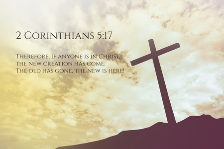 verse: 2 Corinthians 5:17 Vintage Bible Verse Background on one cross on a hill