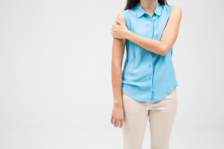 stiffness: woman with shoulder pain or stiffness Stock Photo