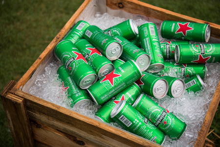 CHIANGMAI, THAILAND - JULY 2, 2016 : Cans of Heineken Beer on crushed ice background. Heineken is a brand of lager beer brewed in Holland.