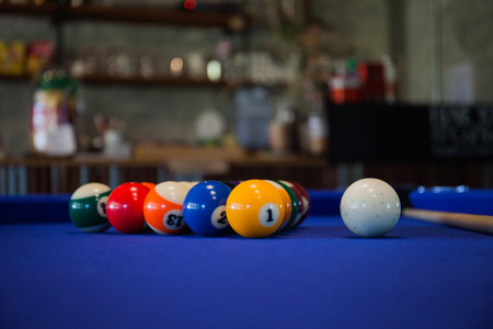Billiard balls composition on blue pool table