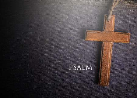 psalm: A cross with Bible book of psalm Stock Photo