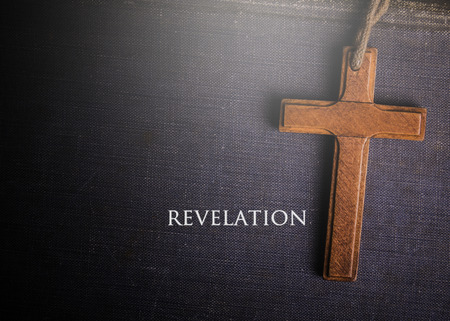 A cross with Bible book of Revelation