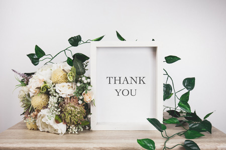 oncept: Thank you word with White frame mockup