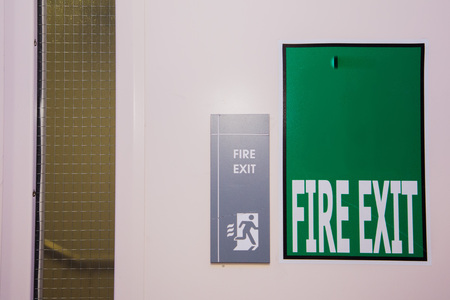 wayout: green and white fire exit sign (guidance to wayout)