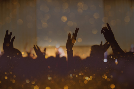 Vintage tone of christian music concert with raised hand Stock Photo
