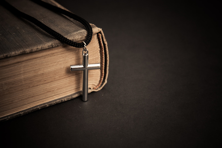 old books with cross. religion concept.