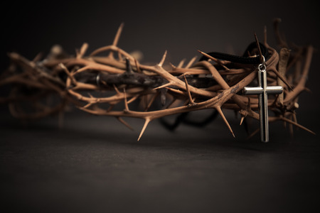 metal cross with crown thorn. religion concept.