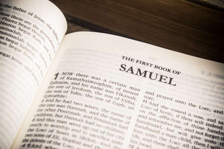"""Old testament in King James version, """"1 Samuel"""" chapter in a Holy Bible."""