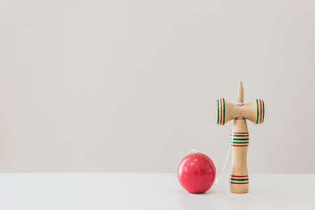 Kendama, a wooden Japanese toy on table.