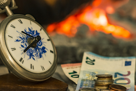 time is money beside the fire Stock Photo