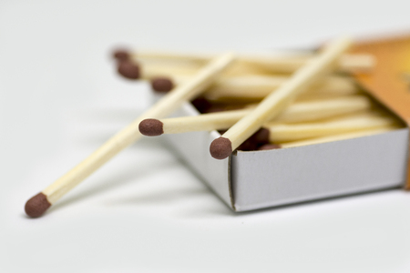 A close-up of wooden matches in a box