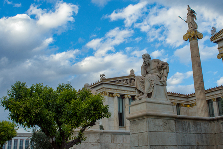 classical statue of Socrates from side with athena statue above Stockfoto