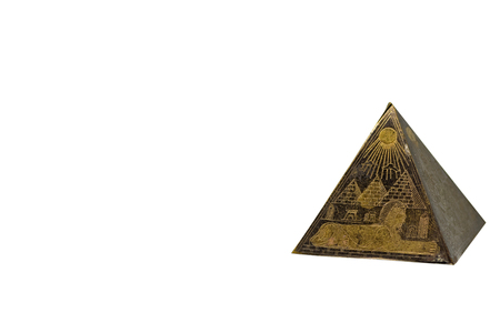 Figurine of egyptian pyramid with copy space background