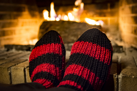womans feet while she is warming in a fireplace