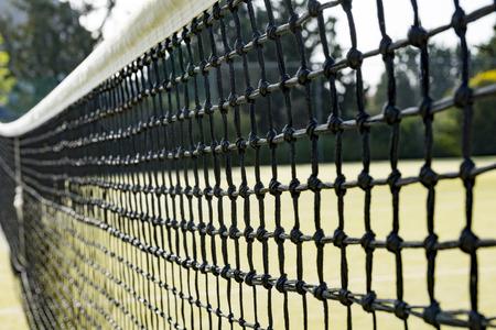 Close up of a black net on a tennis court