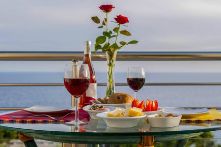 Romance in the table with red wine and snacks