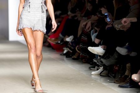 legs of a model catwalk in fashion show